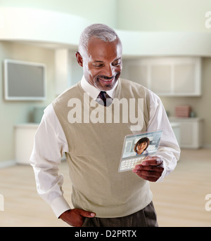 Black businessman using digital tablet in office - Stock Photo
