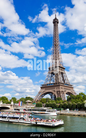 Bateaux Mouches tour boat on River Seine passing the Eiffel Tower, Paris, France, Europe - Stock Photo