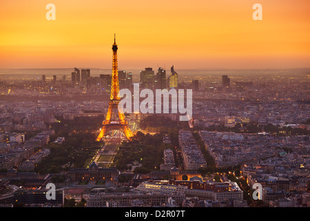 Paris skyline at sunset with the Eiffel Tower and La Defense, Paris, France, Europe - Stock Photo