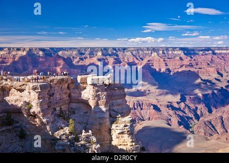 Tourists at Mather Point overlook, South Rim, Grand Canyon National Park, Arizona, USA - Stock Photo