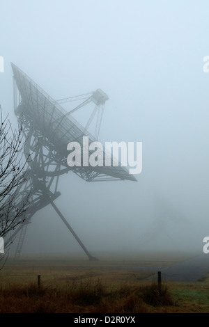Radio Telescopes in the fog in Westerbork, the Netherlands - Stock Photo