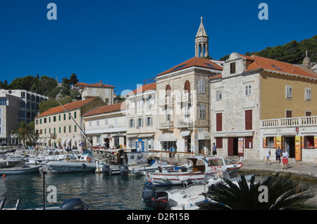 Promenade cafes by the old harbour in the medieval city of Hvar, on the island of Hvar, Dalmatia, Croatia, Europe - Stock Photo