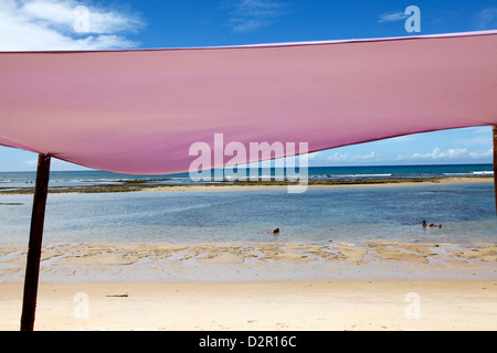 People swimming at Parracho Beach, Arraial d'Ajuda, Bahia, Brazil, South America - Stock Photo