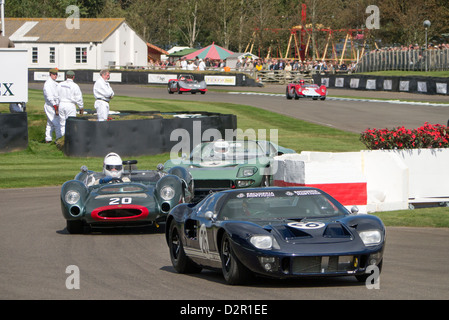 Historic sports cars racing in the Whitsun Cup race. Goodwood revival meeting - Stock Photo