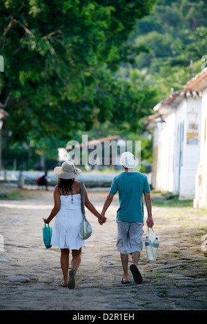Couple walking in the historic part Parati, Rio de Janeiro State, Brazil, South America - Stock Photo