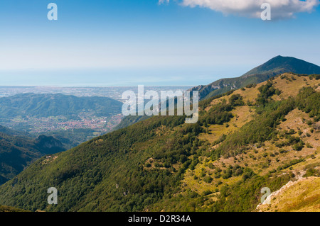 View of Camaiore and Tyrrhenian Sea from Apuan Alps (Alpi Apuane), Lucca Province, Tuscany, Italy, Europe - Stock Photo
