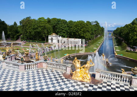Golden statues and fountains of the Grand Cascade at Peterhof Palace with the Marine Canal, St. Petersburg, Russia, - Stock Photo