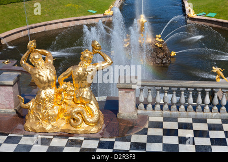Golden statues and fountains of the Grand Cascade at the Peterhof Palace, St. Petersburg, Russia, Europe - Stock Photo