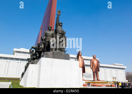 Statues of former Presidents Kim Il Sung and Kim Jong Il, Mansudae Assembly Hall on Mansu Hill, Pyongyang, North - Stock Photo