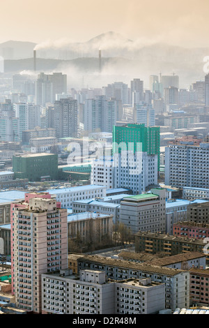 City skyline and pollution from coal fired power plants, Pyongyang, North Korea - Stock Photo