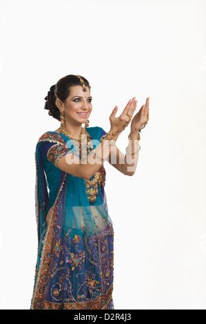 Woman gesturing at Diwali festival - Stock Photo