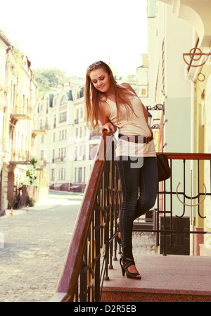 Cute Smiling Young Woman Upstairs Posing Outdoors - Stock Photo
