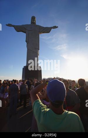 Tourists looking at Christ the Redeemer statue (Cristo Redentor), Corvocado, Rio de Janeiro, Brazil, South America - Stock Photo
