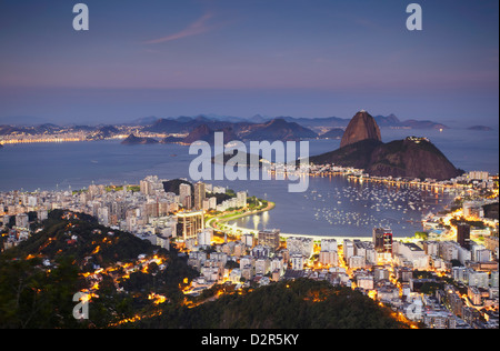 View of Sugar Loaf Mountain (Pao de Acucar) and Botafogo Bay at dusk, Rio de Janeiro, Brazil, South America - Stock Photo
