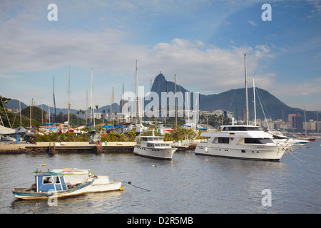 Boats in Guanabara Bay with Christ the Redeemer statue (Cristo Redentor) in the background, Urca, Rio de Janeiro, - Stock Photo