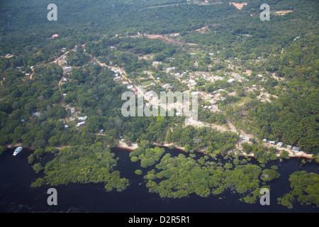 Aerial view of settlement in Amazon rainforest along the Rio Negro, Manaus, Amazonas, Brazil, South America - Stock Photo