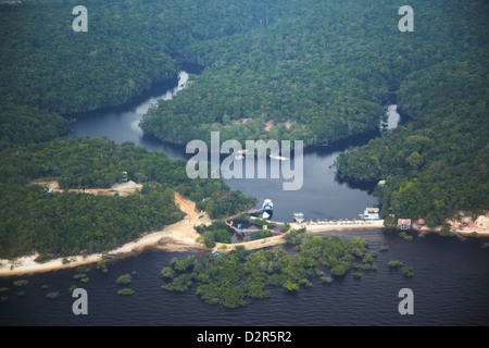 Aerial view of Amazon rainforest and beach resort along the Rio Negro, Manaus, Amazonas, Brazil, South America - Stock Photo