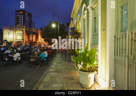 People eating at outdoor restaurants in Praca Sao Sebastiao (St. Sebastian Square) at dusk, Manaus, Amazonas, Brazil - Stock Photo