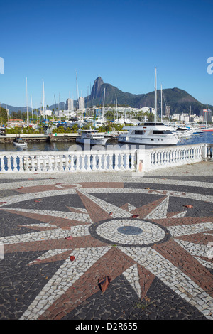 Boats moored in the harbour with Christ the Redeemer statue in background, Urca, Rio de Janeiro, Brazil, South America - Stock Photo