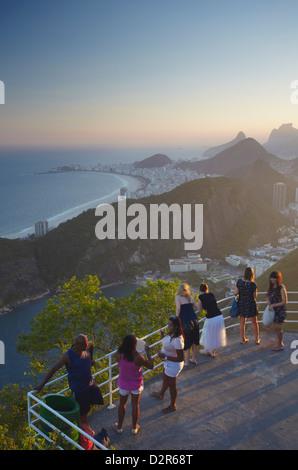 Tourists enjoying view from Sugar Loaf Mountain (Pao de Acucar), Rio de Janeiro, Brazil, South America - Stock Photo