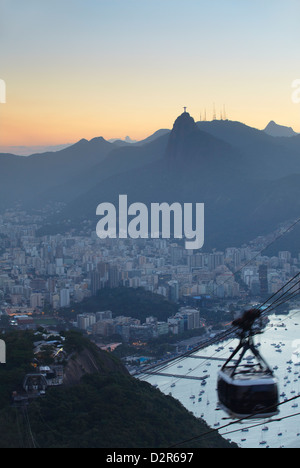 View of Christ the Redeemer statue and Botafogo Bay from Sugar Loaf Mountain, Rio de Janeiro, Brazil, South America - Stock Photo