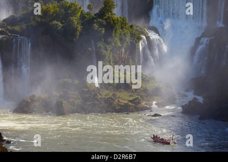 Tourist boat approaching Argentinean side of Iguacu Falls, Iguacu National Park, Parana, Brazil - Stock Photo