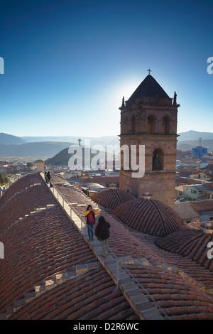 People on rooftop of Convento de San Francisco, Potosi, UNESCO World Heritage Site, Bolivia, South America - Stock Photo