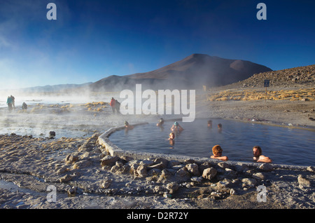 Tourists in hot springs of Termas de Polques on the Altiplano, Potosi Department, Bolivia, South America - Stock Photo