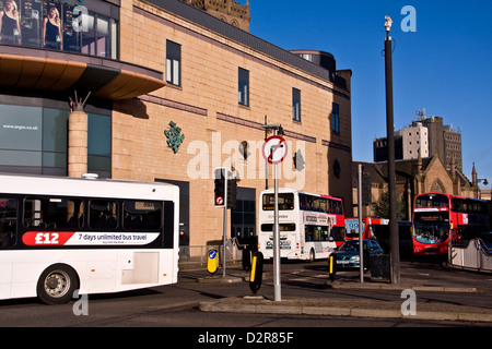 City Buses displaying 7day unlimited travel for £12 while travelling past the Overgate shopping centre in Dundee,UK - Stock Photo