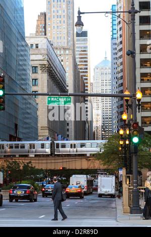 El train crossing North Clark Street, The Loop, Chicago, Illinois, United States of America, North America - Stock Photo