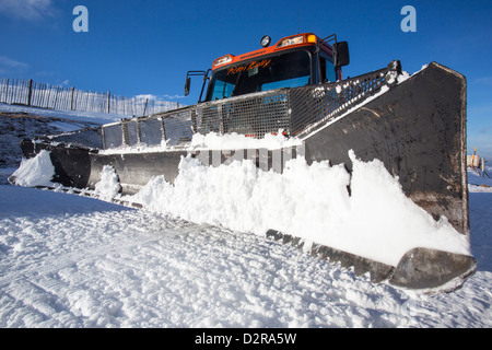 A piste basher on a ski run in the Cairngorm mountains. climate change threatens the viability of many ski resorts. - Stock Photo