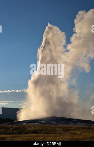Old Faithful Geyser erupting, Yellowstone National Park, Wyoming, USA - Stock Photo