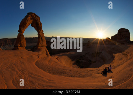 Two men sitting, Delicate Arch, Arches National Park, Moab, Utah, United States of America, North America - Stock Photo