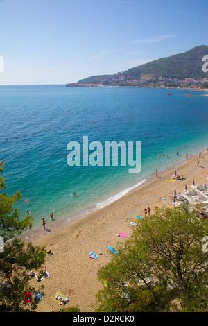 View of Slovenka Plaza Beach and Budva, Budva, Montenegro, Europe - Stock Photo