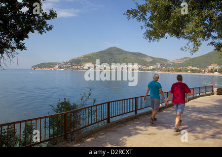 Walkers and Old Town, Budva Bay, Montenegro, Europe - Stock Photo