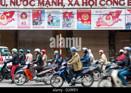 Unidentified men and women drive their motorcycles on January 14, 2008 in Hanoi, Vietnam. - Stock Photo