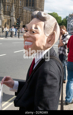 A protester wearing a satirical Tony Blair mask at an anti war protest in central London in the UK. - Stock Photo