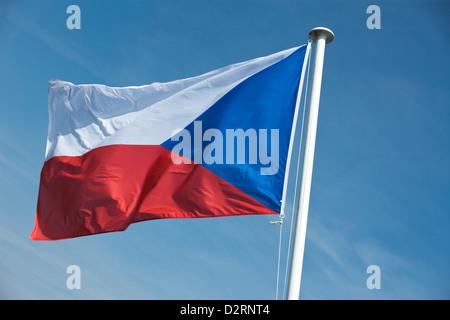 CZECH REPUBLIC FLAG FLYING ON FLAGPOLE - Stock Photo