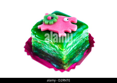 Petit Fours, little, small cakes. Sweet, dyed, with lucky charm symbolic decoration. - Stock Photo
