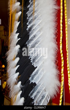 Closeup detail of Native American Navajo Indian chief headdress made of real feathers, tourist souvenir Rapid City - Stock Photo