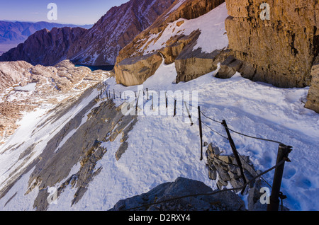 Railing on the Mount Whitney trail above high camp, John Muir Wilderness, California USA - Stock Photo