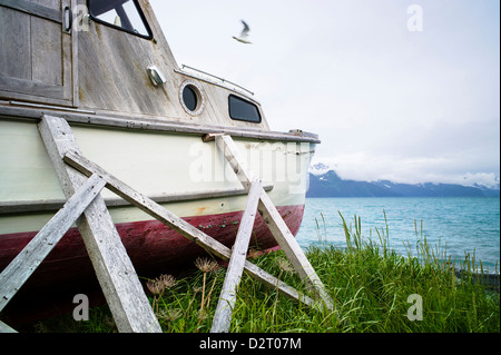 Old wooden fishing boat on the beach, Resurrection Bay, Seward, Alaska, USA - Stock Photo