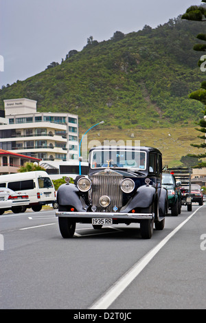 1935 Rolls Royce being driven along the waterfront in Mt Maunganui, Bay of Plenty, North Island, New Zealand. - Stock Photo