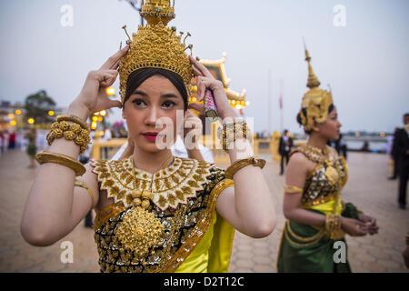 Phnom Penh, Cambodia. 1st February 2013.  Cambodian Aspara dancers prepare to walk in the funeral procession of - Stock Photo