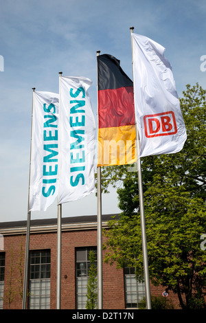 Krefeld, Germany, Siemens Mobility, Siemens and DB flags - Stock Photo