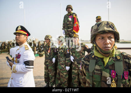 Phnom Penh, Cambodia. 1st February 2013.  Cambodian military officials watch the funeral procession of former King - Stock Photo