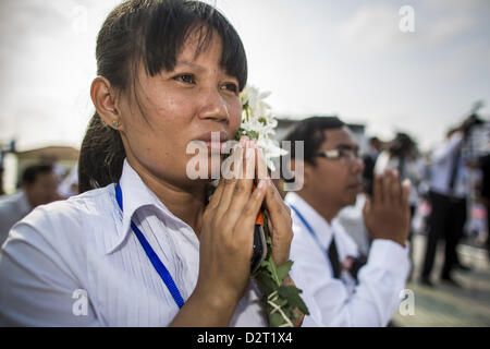 Phnom Penh, Cambodia. 1st February 2013.  A mourner watches the funeral procession of former Cambodian King Norodom - Stock Photo