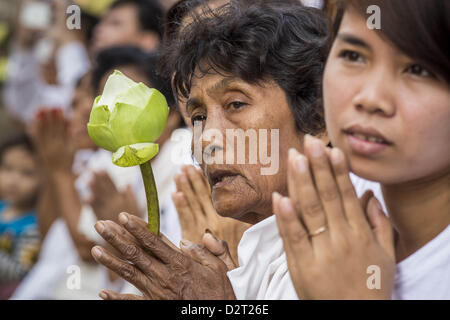 Phnom Penh, Cambodia. 1st February 2013.  Cambodian mourners watch the funeral procession of former King Norodom - Stock Photo