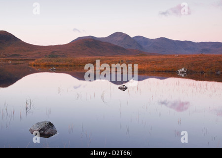 Lochan na h-Achlaise reflecting the surrounding mountains on Rannoch Moor, a Site of Special Scientific Interest, - Stock Photo