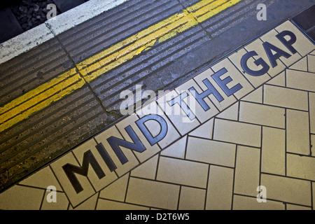 MIND THE GAP sign on platform edge, London Underground, London, England, United Kingdom, Europe - Stock Photo